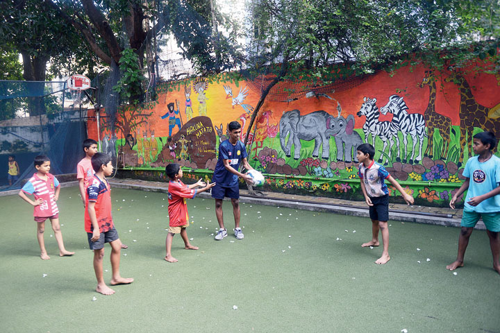 Jahangir Ali (with ball in his hands) plays a game of rugby at Future Hope School on Saturday.