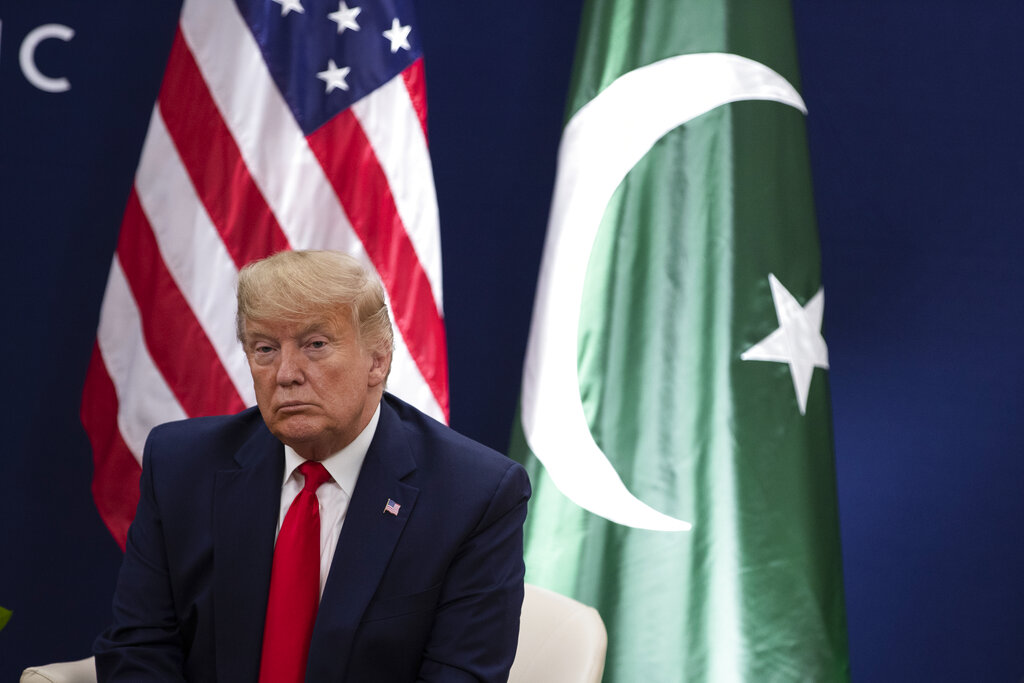 President Donald Trump listens during a meeting with Pakistani Prime Minister Imran Khan at the World Economic Forum, Tuesday, January 21, 2020, in Davos, Switzerland