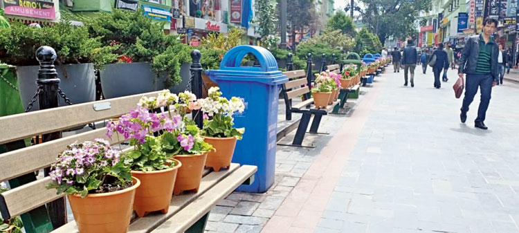 Flower pots placed on benches at MG Marg in Gangtok on Tuesday, a day before the start of lockdown in Sikkim