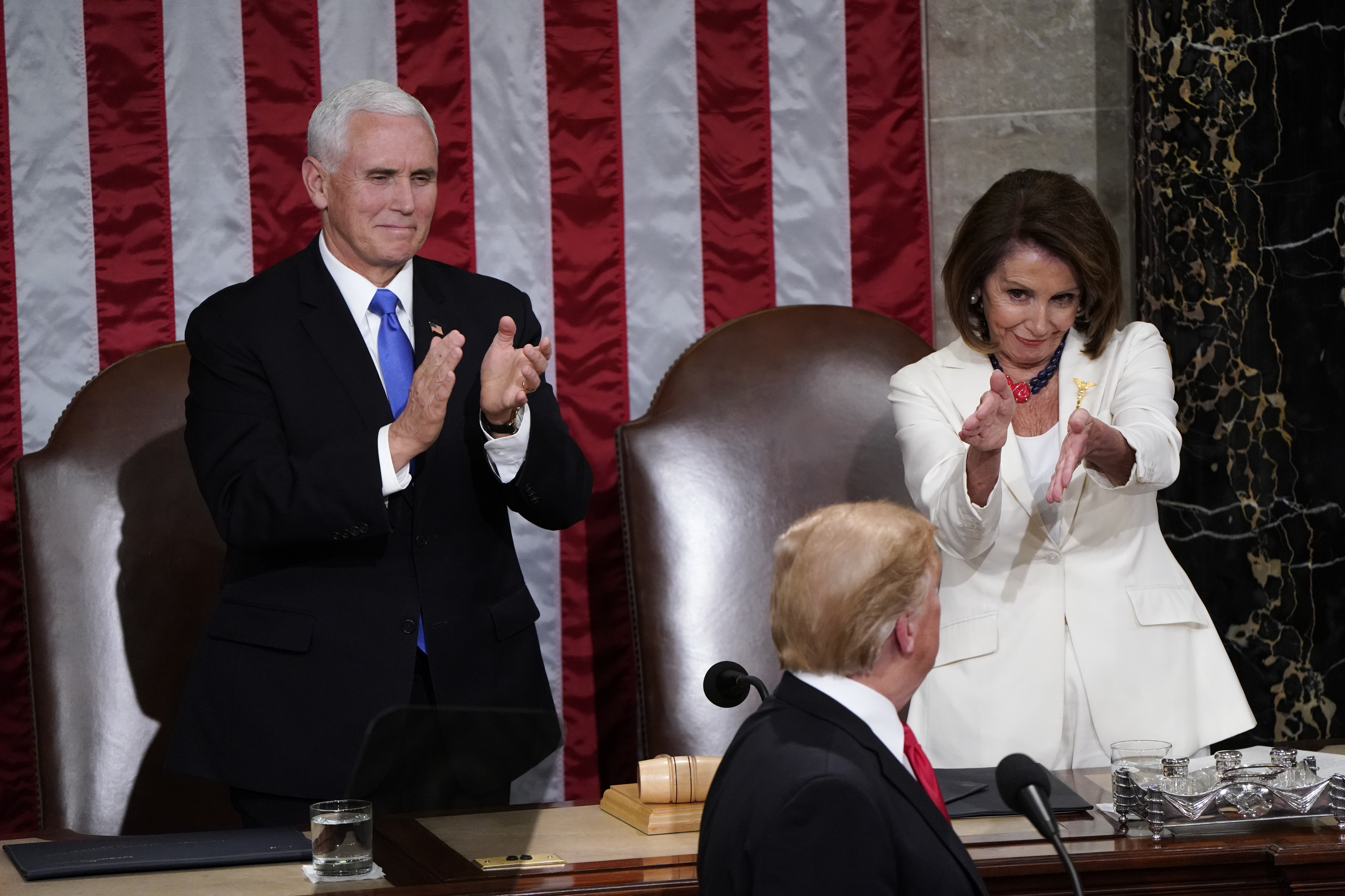 Nancy Pelosi was one of many, many Congresswomen in white jackets and suits.