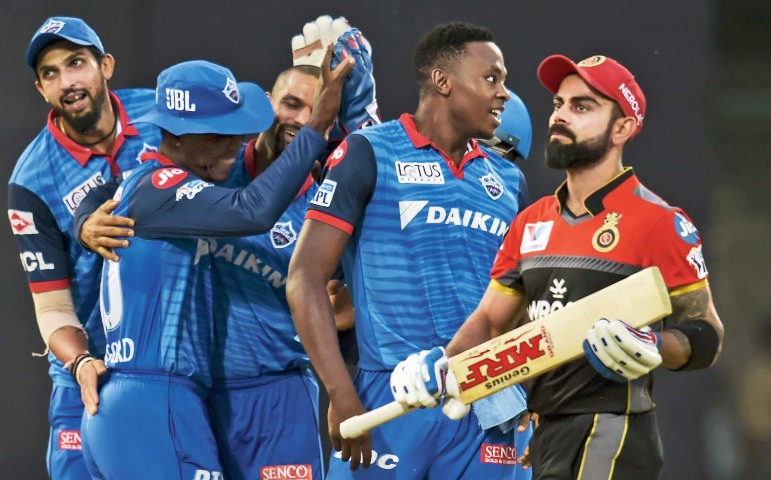 Delhi Capitals players celebrate after the dismissal of Royal Challengers Bangalore captain Virat Kohli on Sunday.