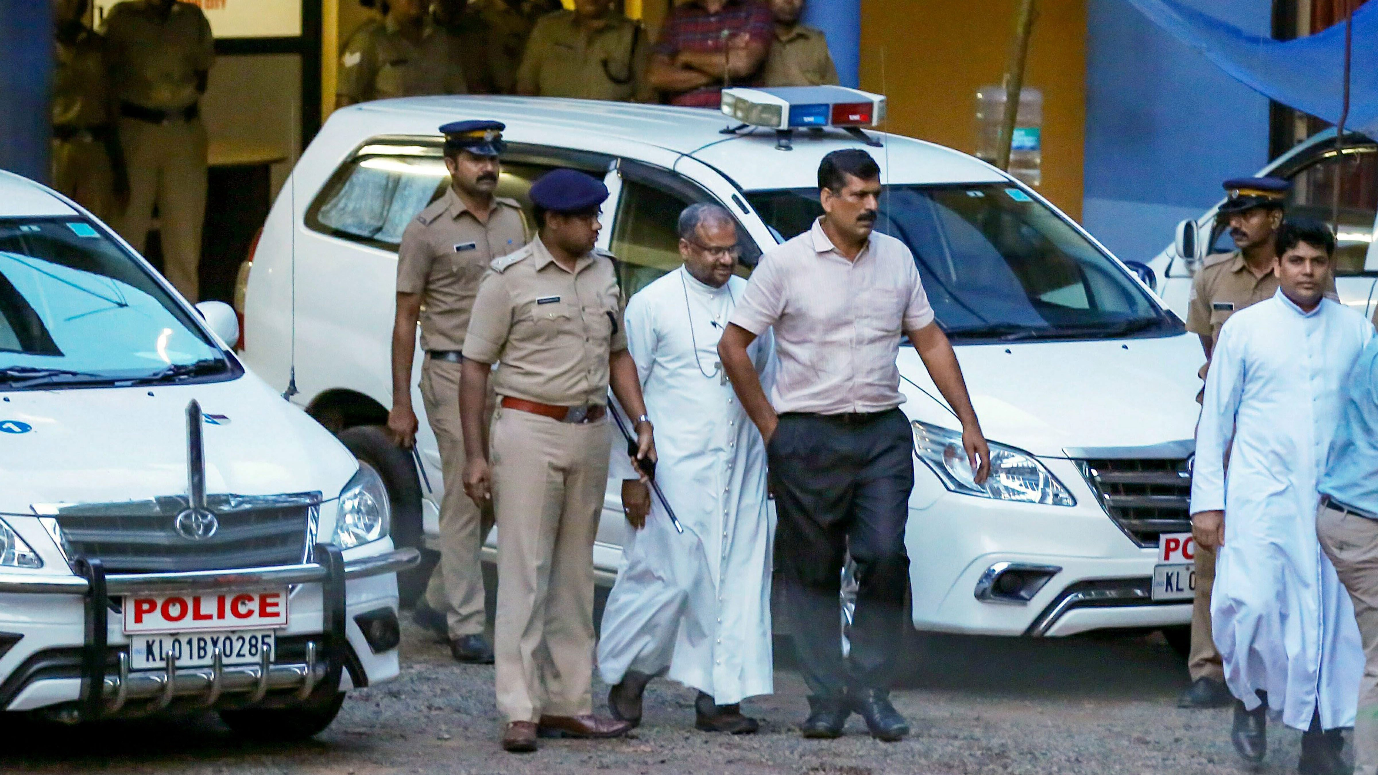 Bishop Franco Mulakkal, accused of raping a nun, leaves after questioning before the special investigation team of the Kerala police on Sept. 20