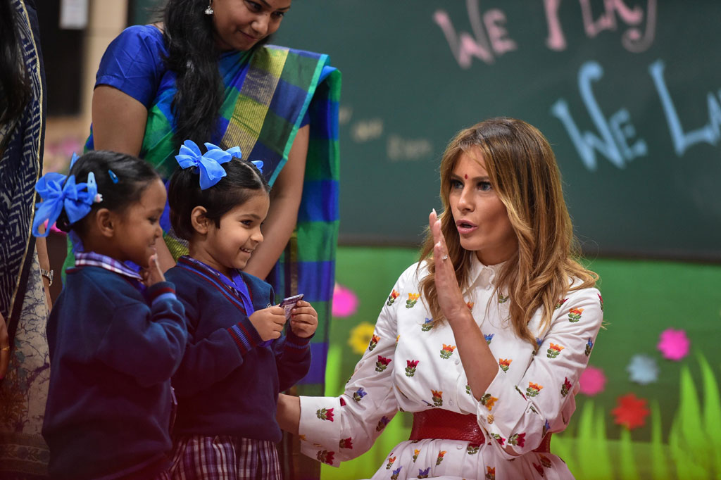 US First Lady Melania Trump interacts with school children during her visit to a government school to witness various activities as part of the happiness curriculum, in New Delhi
