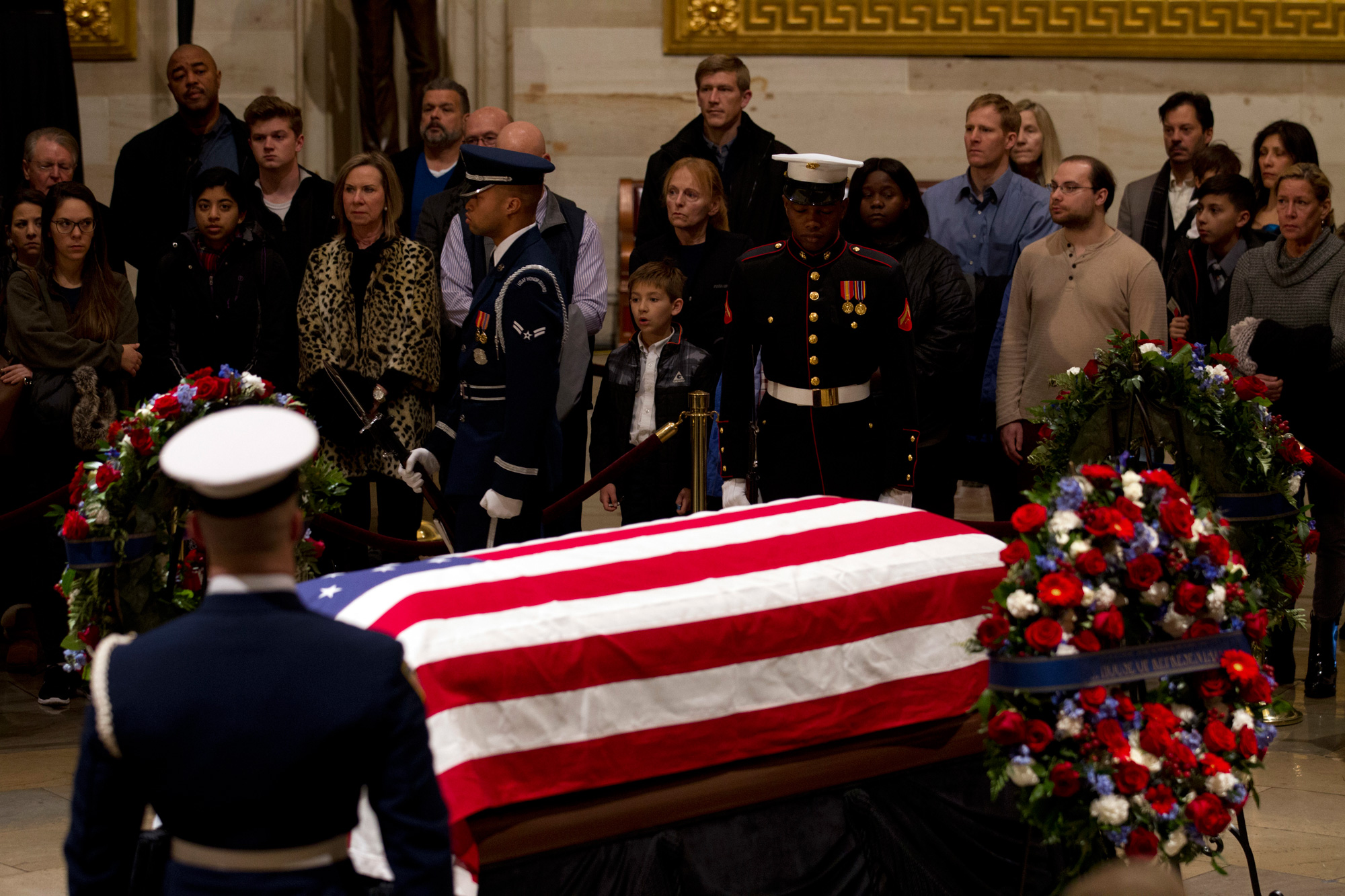 Visitors pay their respects at the flag-draped casket of former President George H.W. Bush, as he lies in state in the Capitol Rotunda in Washington on Wednesday.