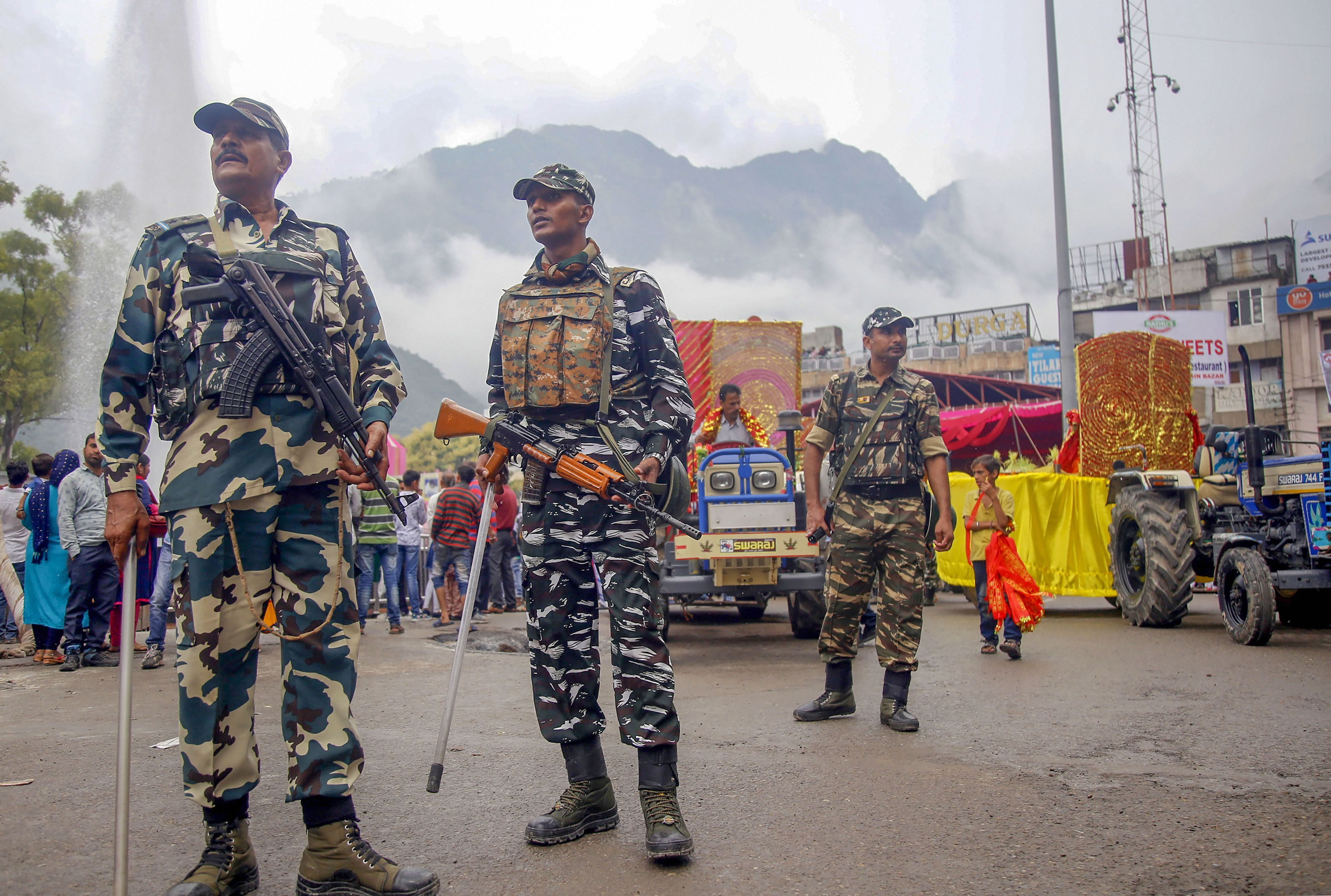 CRPF soldiers stand guard during a procession on the the first day of Navratri festival at Katra, about 45 kms from Jammu, Sunday, September 29, 2019.