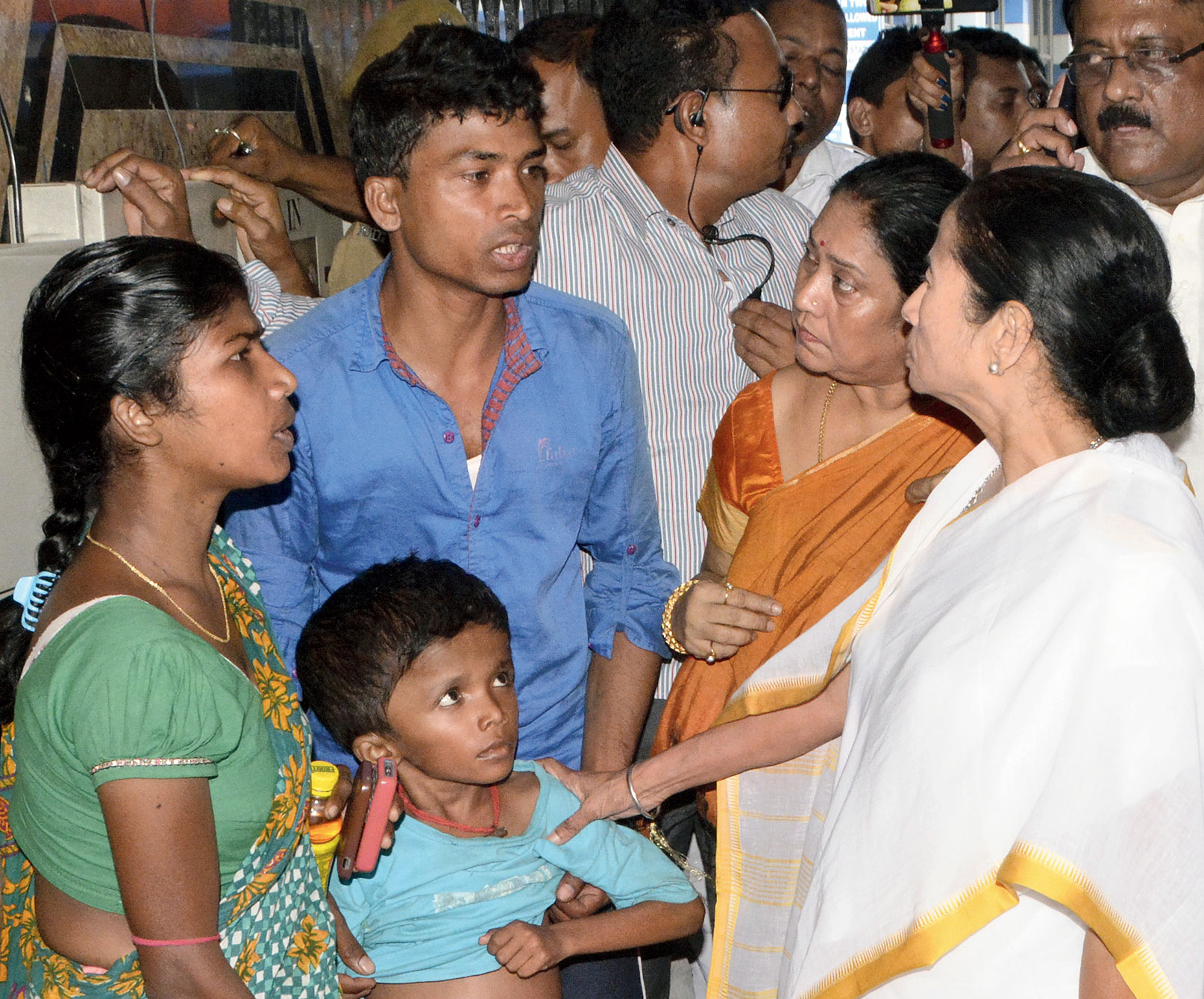 Chief minister Mamata Banerjee speaks to relatives of a boy from Purulia with a tumour in his stomach during her visit to SSKM Hospital on Thursday afternoon