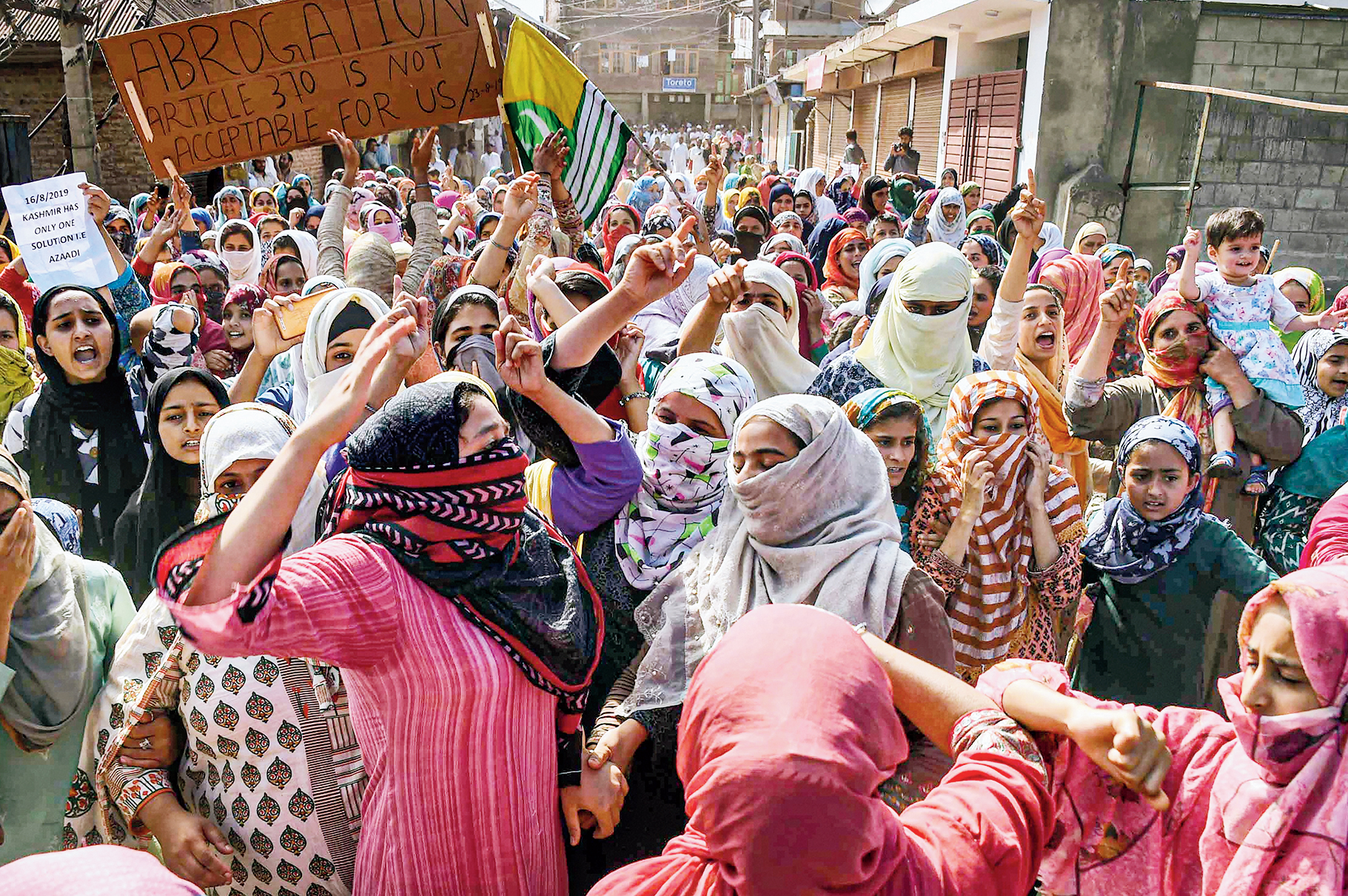 Women raise slogans during a peaceful protest march in Srinagar on Friday.