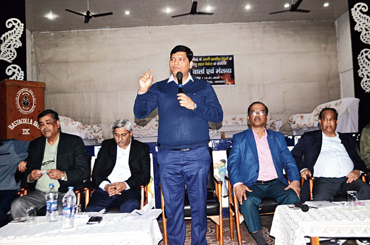 Deputy Collector Amit Kumar addresses the rehabilitation meeting at Bastacola Officer's Club in Jharia on Tuesday.