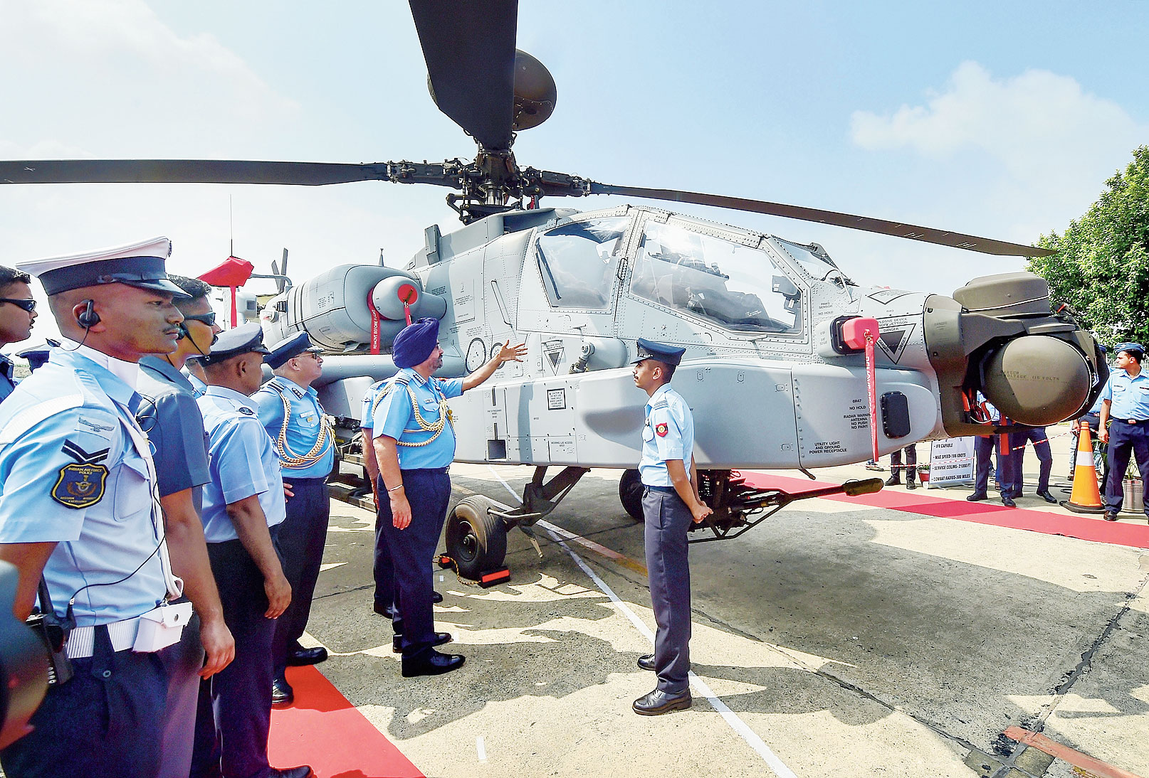 Air Chief Marshal BS Dhanoa inspects one of the eight US-made Apache AH-64E helicopters that were inducted into the IAF at the air force station in Pathankot on Tuesday.