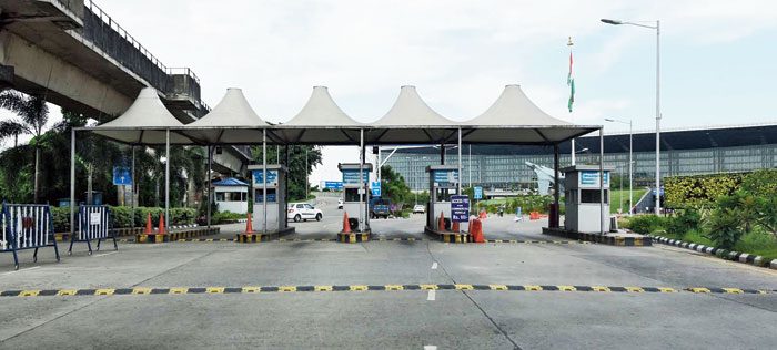 Empty booths and open drop gates at the airport on Thursday. The booths are usually manned and cars going in are handed tokens mentioning the time of entry.