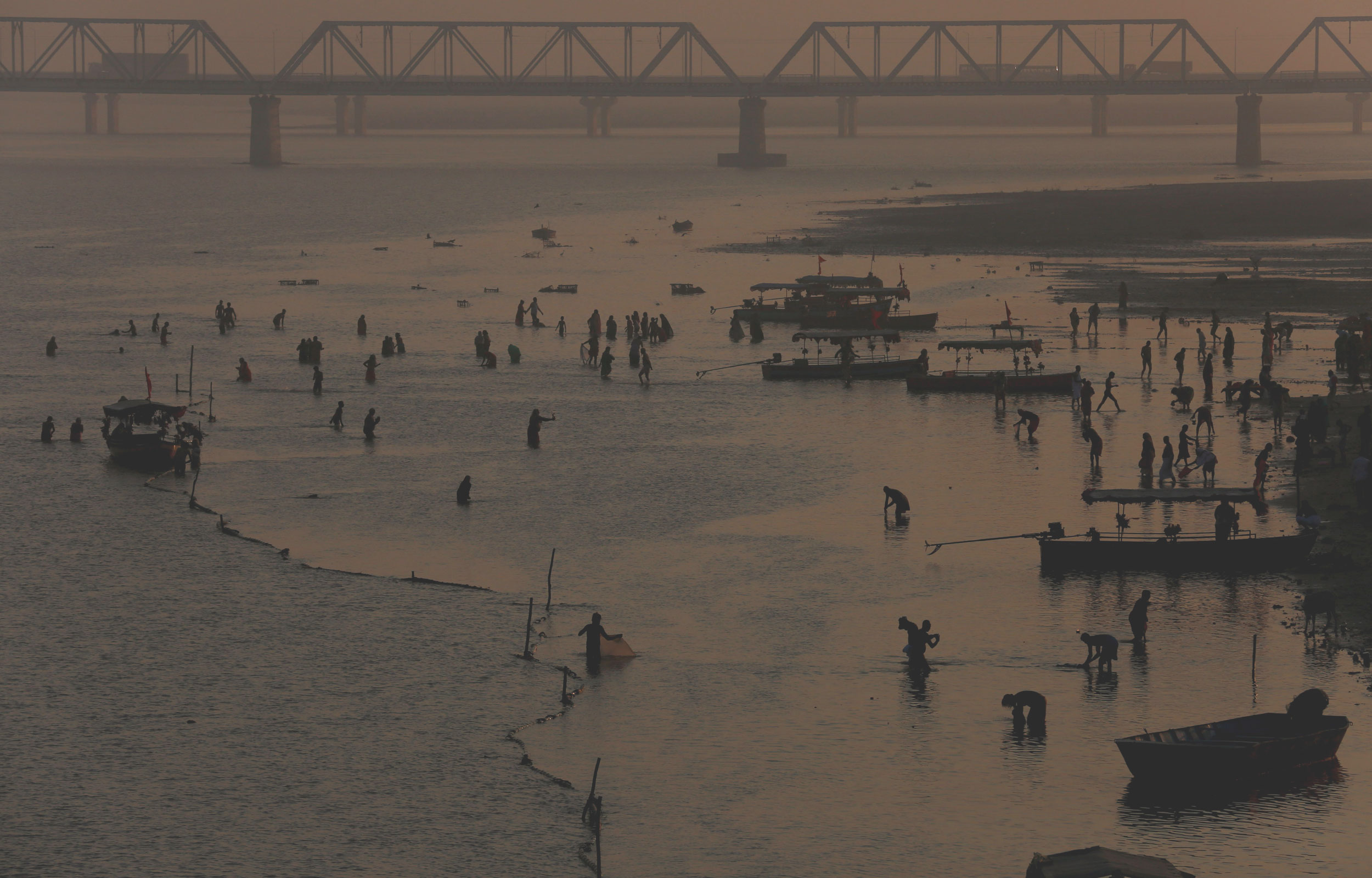 Hindu devotees pray on the banks of the Saryu River in Ayodhya. To provide 'restitution' to the Muslim community for the unlawful destruction of its place of worship, the Supreme Court has also asked the State to hand over five acres of land at a 'prominent' place in Ayodhya.