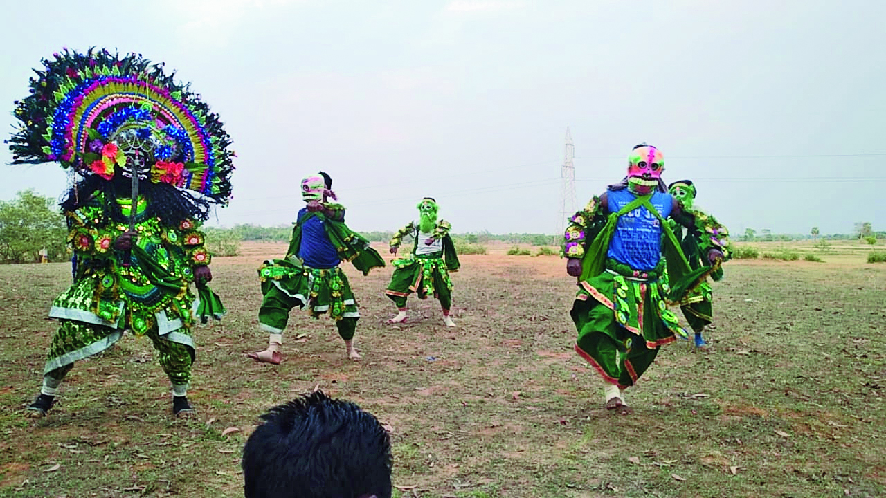 Chhau dancers perform a dance drama to spread awareness about Covid-19.