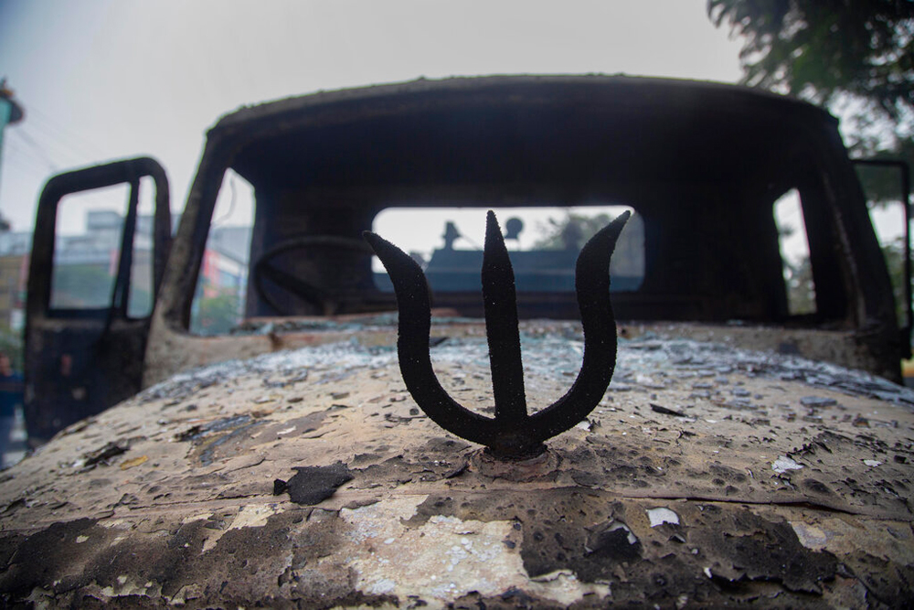 A trident on a car burnt during the protest against the Citizenship (Amendment) Bill in Guwahati on December 12