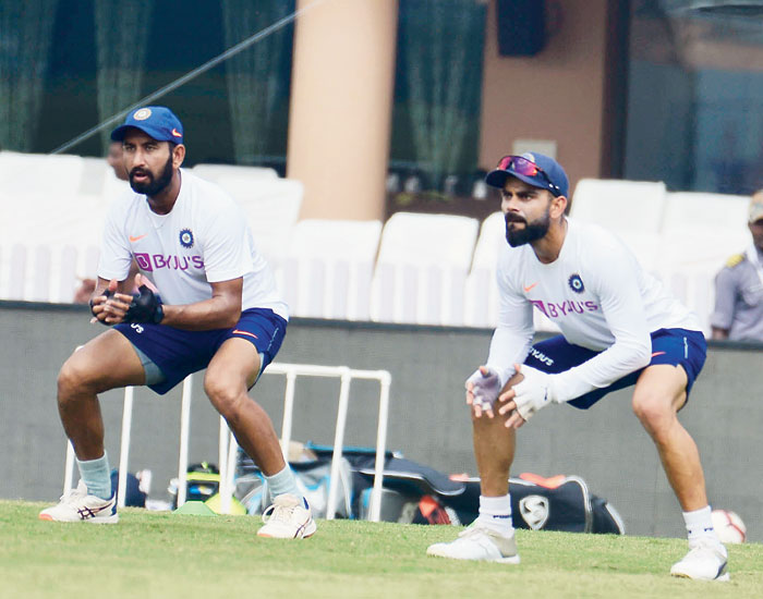 Virat Kohli (right) and Cheteshwar Pujara during a practice session at JSCA International Cricket Stadium in Ranchi on Friday