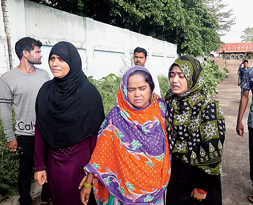 Shaista Perveen (in green salwar) in Seraikela in June after the death of her husband, Tabrez Ansari.