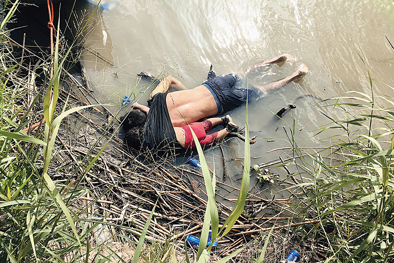 The bodies of Salvadoran migrant Oscar Alberto Martinez Ramirez and his daughter Angie Valeria lie on the bank of the Rio Grande river in Matamoros, Mexico, after they drowned trying to cross the river to Brownsville, Texas.