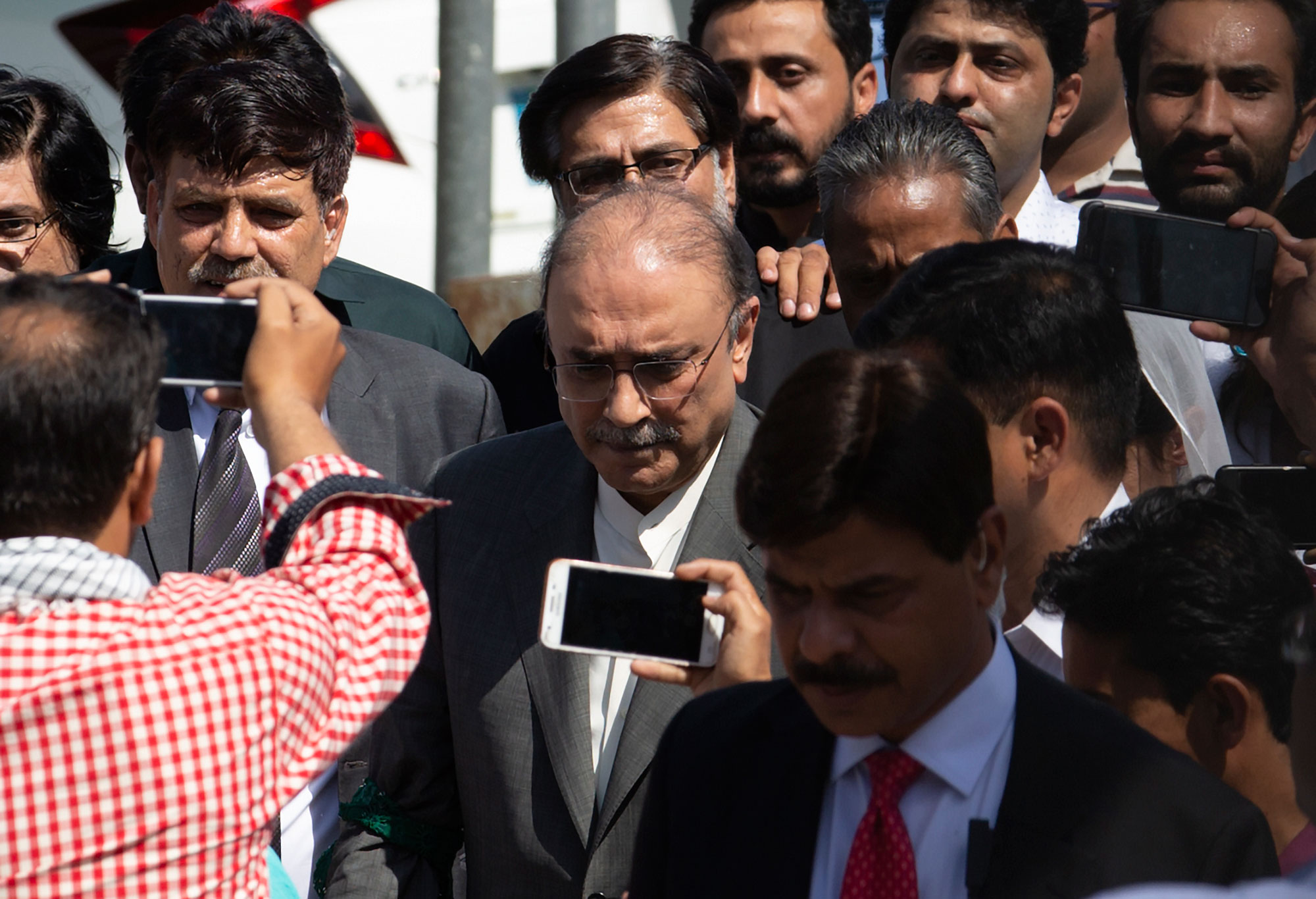 Asif Ali Zardari (centre) leaves the High Court building, in Islamabad, Pakistan, on June 10, 2019.
