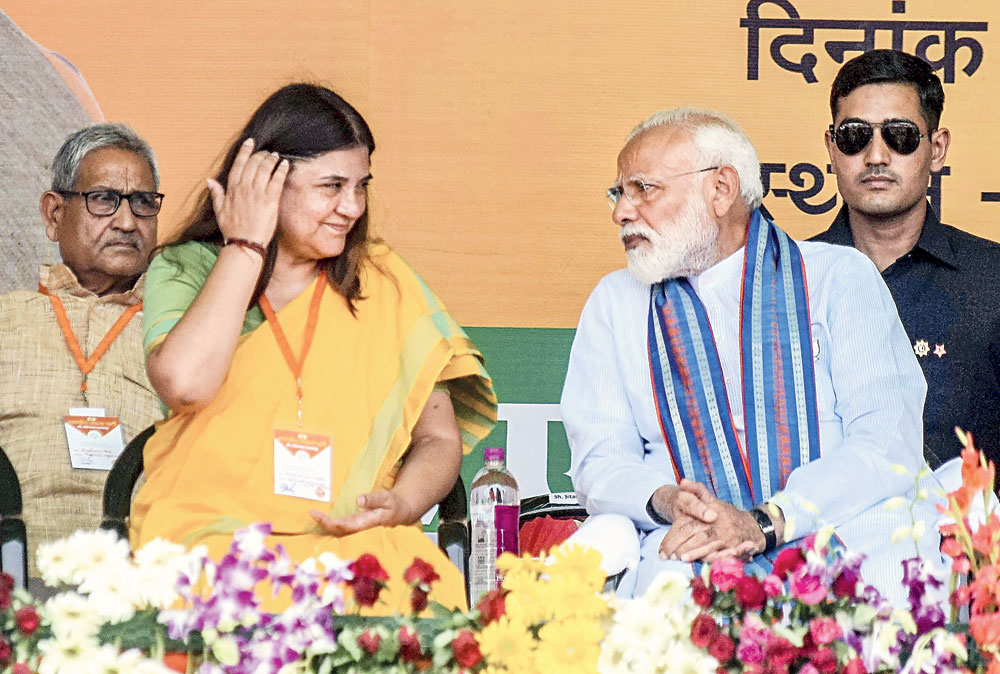 Prime Minister Narendra Modi with Union minister Maneka Gandhi during a campaign rally in Pratapgarh on May 4