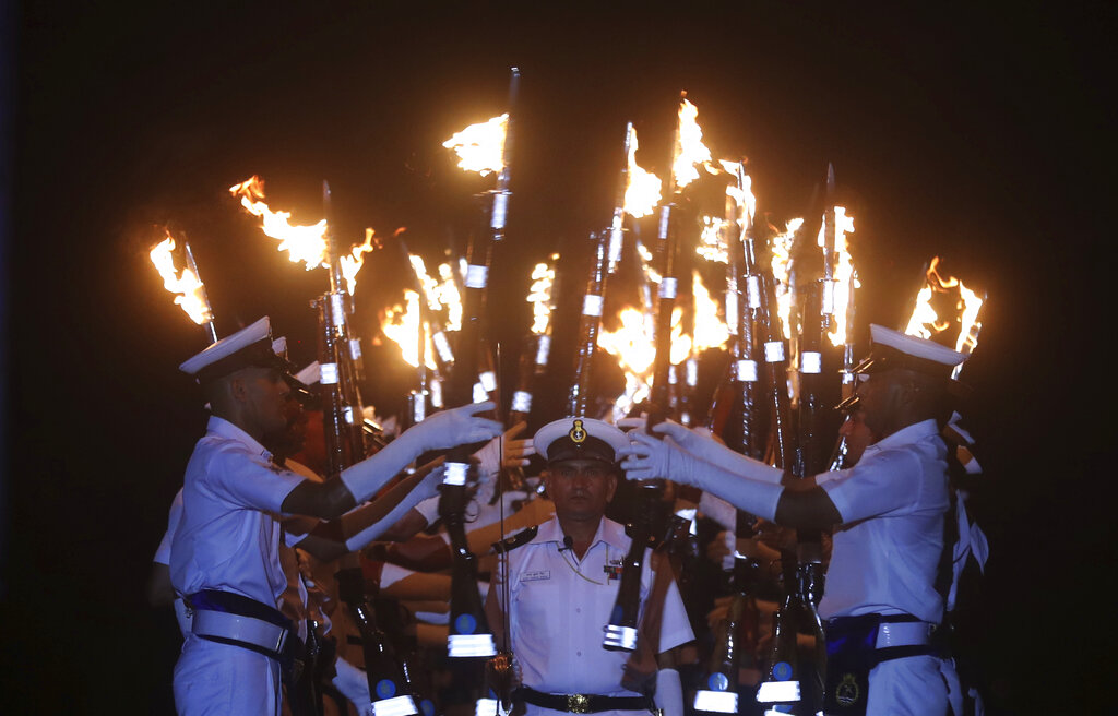 Indian navy personnel display their skills during a rehearsal for Naval Day celebrations in Mumbai, on Sunday, Dec. 1, 2019.