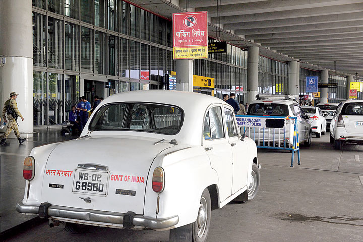 VIP vehicles stand along the no-parking zone
