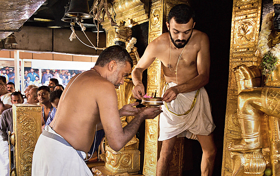 Priests carry out purification of the Sabarimala temple after the women entered the shrine on Wednesday.