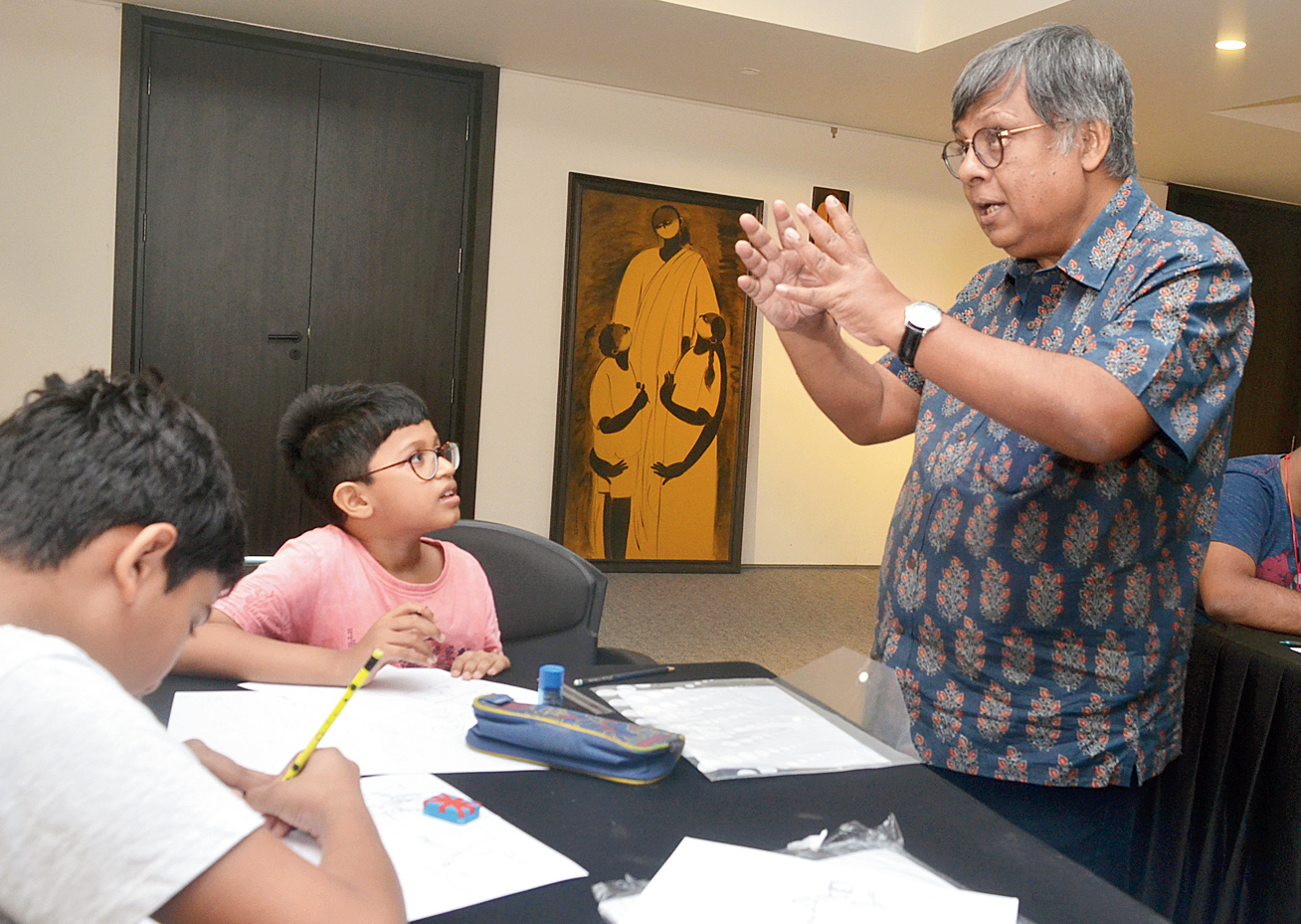 Cartoonist Debkumar Mitra shows students how to convert their stories into comic strips.