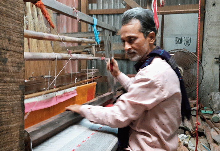 Amulya Basak at his handloom.