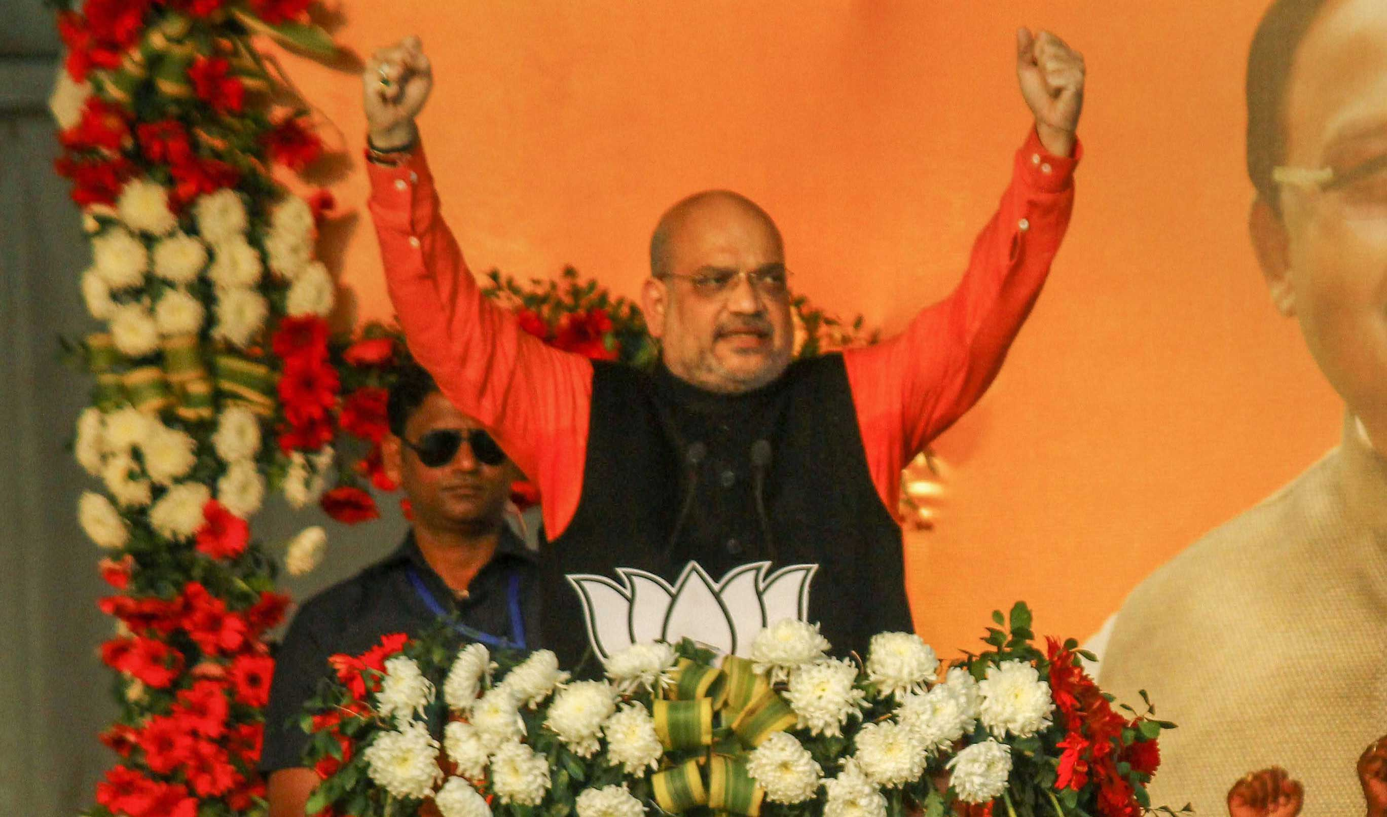 Amit Shah speaks during the national tribal convention in Puri on Sunday.