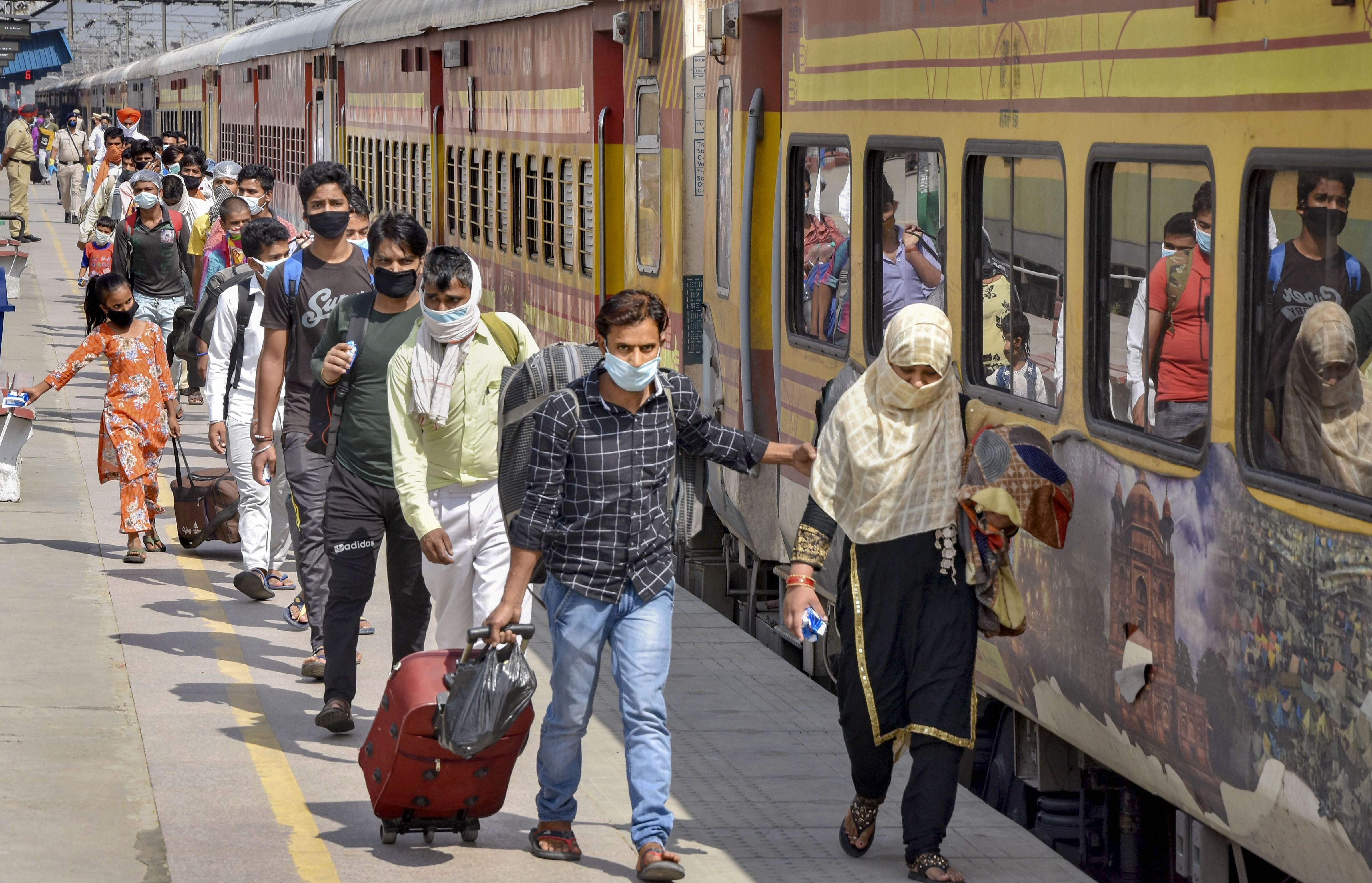 Migrants board a special train to reach Lucknow, during the ongoing Covid-19 lockdown, in Jalandhar, Wednesday, May 6, 2020
