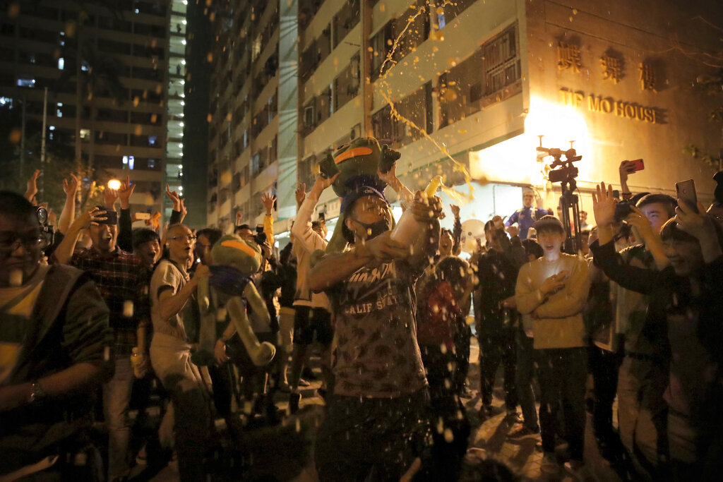 Pro-democracy supporters celebrate after pro-Beijing politician Junius Ho lost his election in Hong Kong, early Monday, November 25, 2019. Vote counting was underway in Hong Kong early Monday.