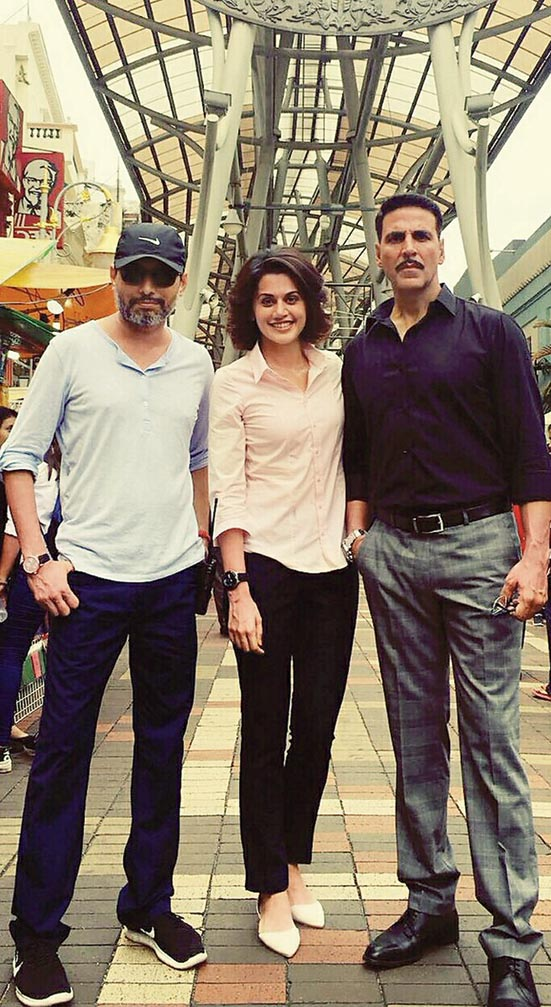 Neeraj Pandey (left) with Taapsee Pannu and Akshay Kumar on the sets of Naam Shabana, produced by him