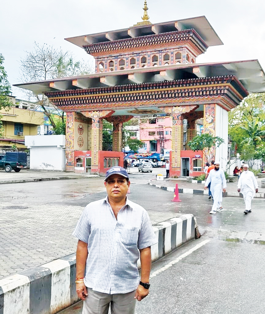 Ajay Sharma against the backdrop of the Bhutan Gate in Phuentsholing.