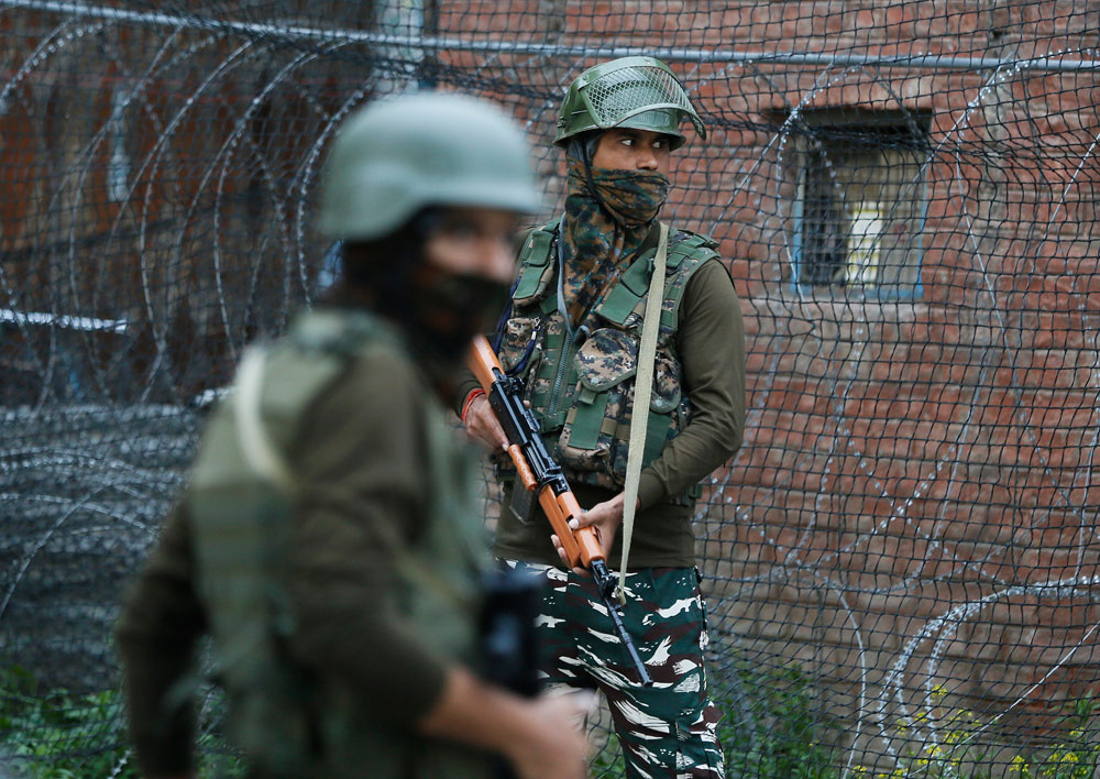 Paramilitary troopers stand guard in Srinagar on Wednesday