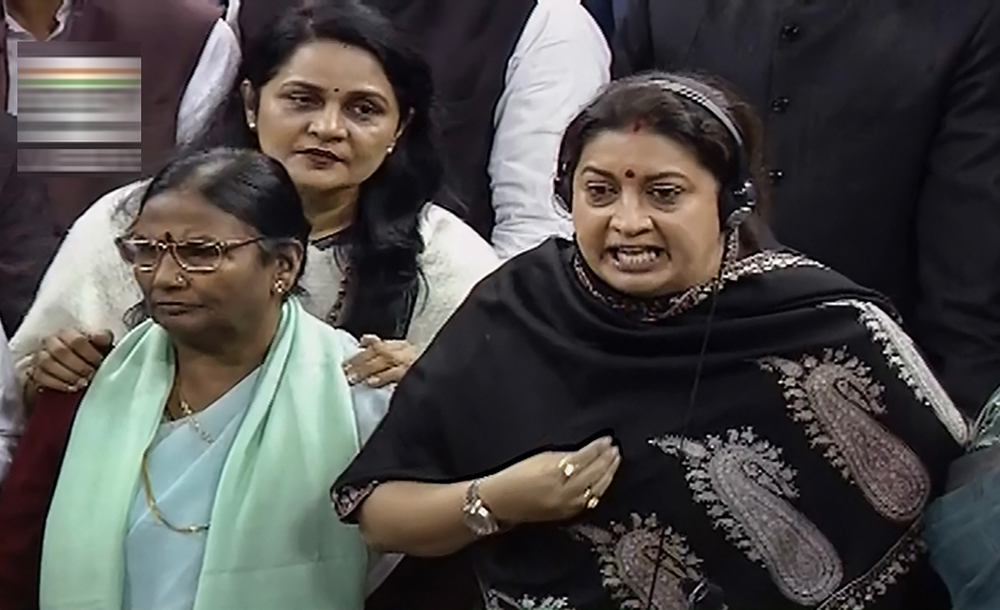 Smriti Irani and fellow BJP members react to Rahul Gandhi's remarks in the Lok Sabha on Friday