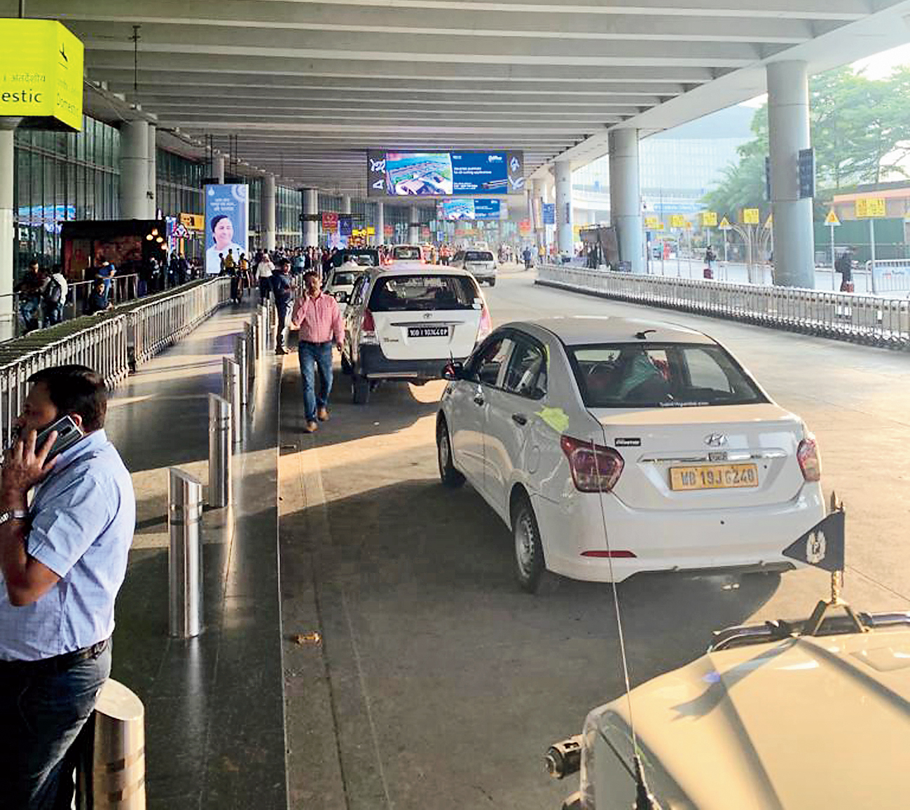 VIP cars block another lane outside the terminal