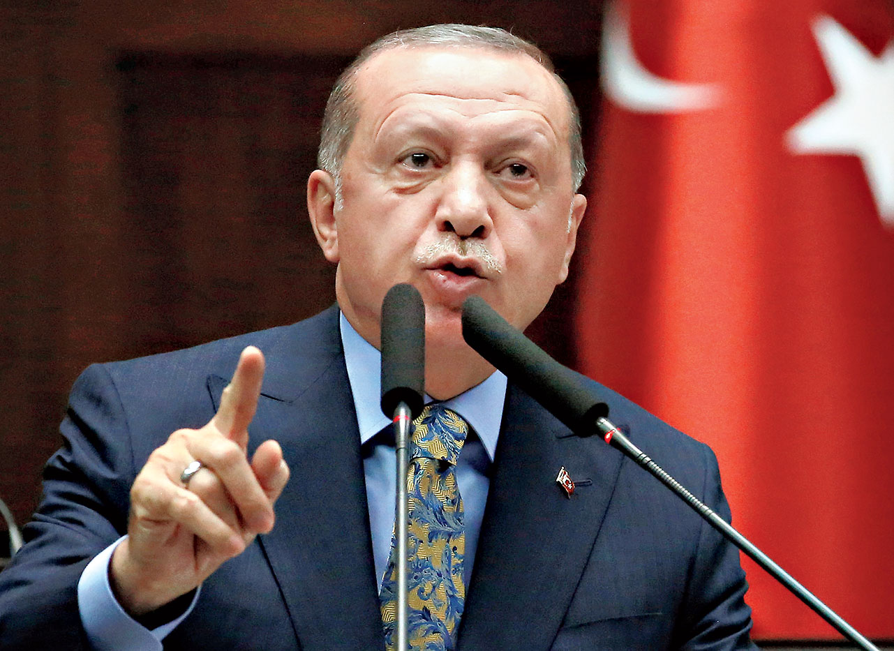 Turkish President Tayyip Erdogan addresses ruling party MPs during a meeting in Ankara.