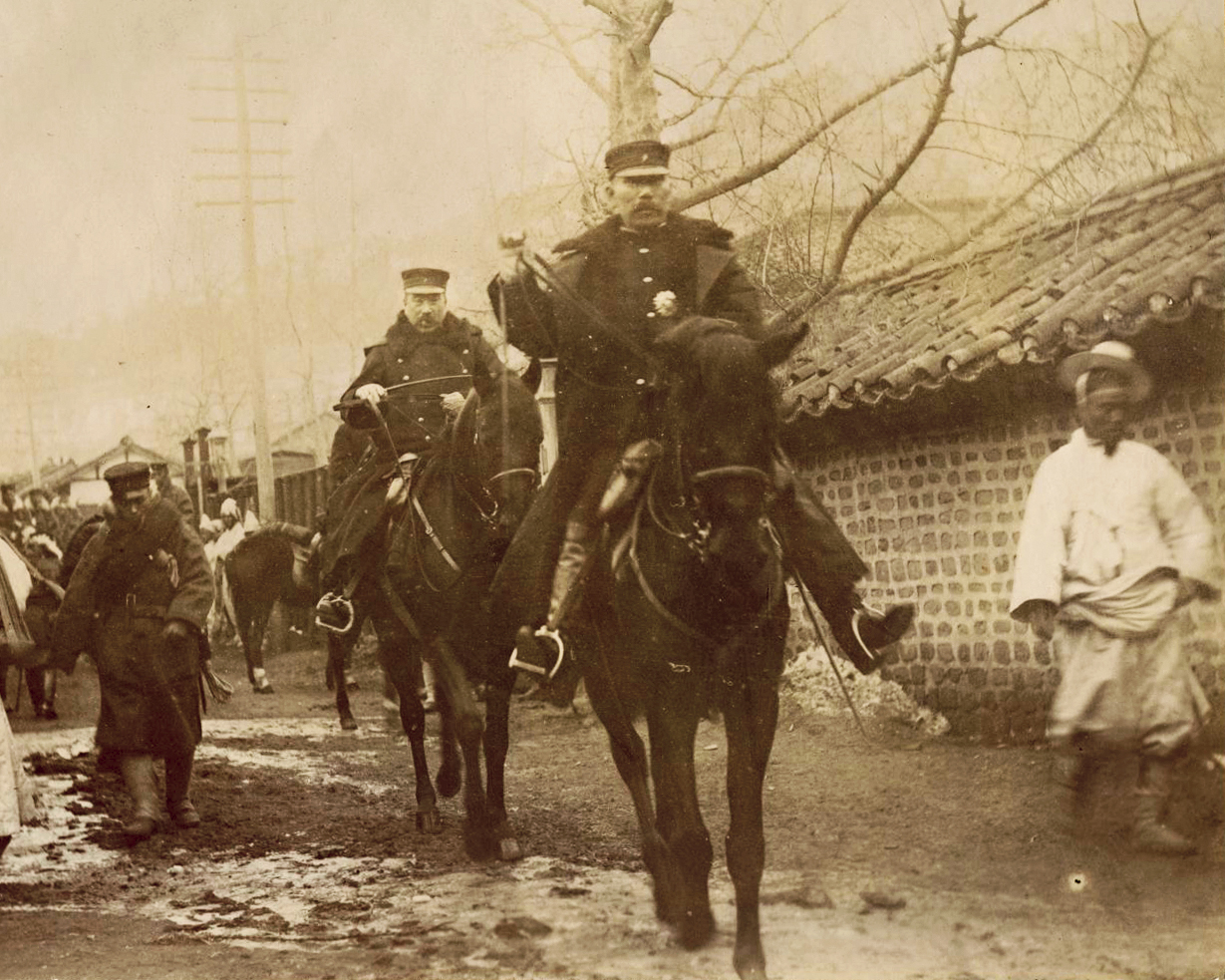 Japanese officers on horseback in a narrow street in Seoul. The division of the Korean Peninsula was one visible outcome of the defeat of Japan and the end of World War II in Asia
