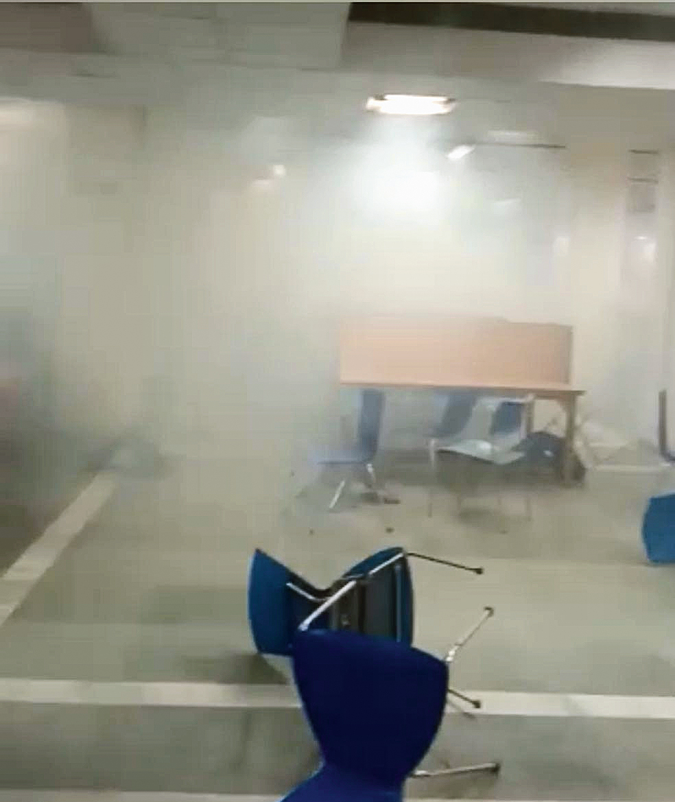 A screenshot from a video clip sent by Ahmad Azeem, public relations officer, Jamia Millia Islamia, shows the tear-smoke-filled Zakir Husain Library, named after the former President who co-founded the institution, in the university on Sunday evening