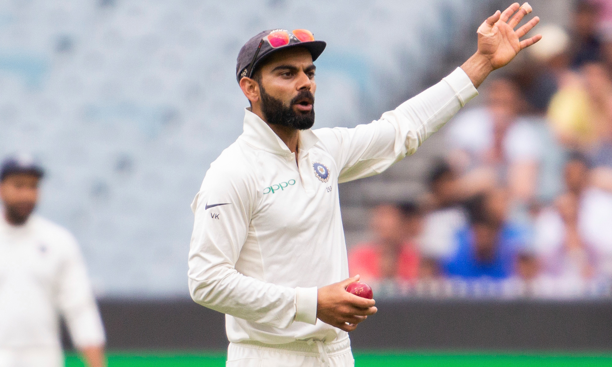 India's captain Virat Kohli makes a gesture while in the field during play on day four of the third cricket test between India and Australia in Melbourne, Australia on Saturday, December 29, 2018.
