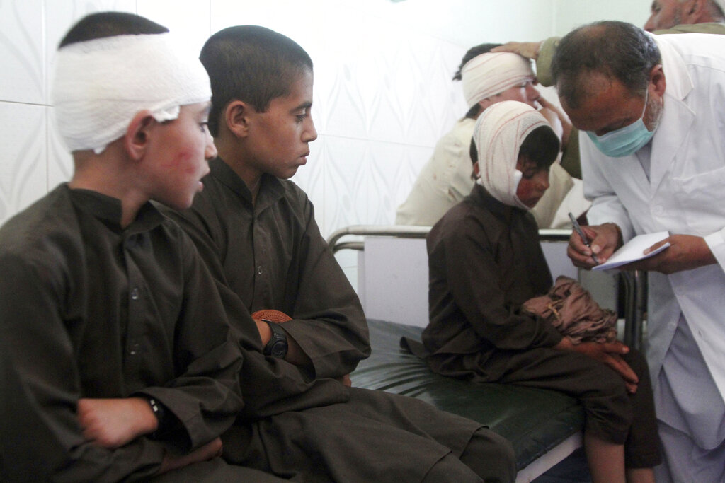 Injured boys receive treatment in a hospital after a car bomb attack in Ghazni province, central Afghanistan, Sunday, July 7, 2019. Afghan officials say a car bomb in central Afghanistan has killed a few people and wounded dozens of people, many of them students attending a nearby school.
