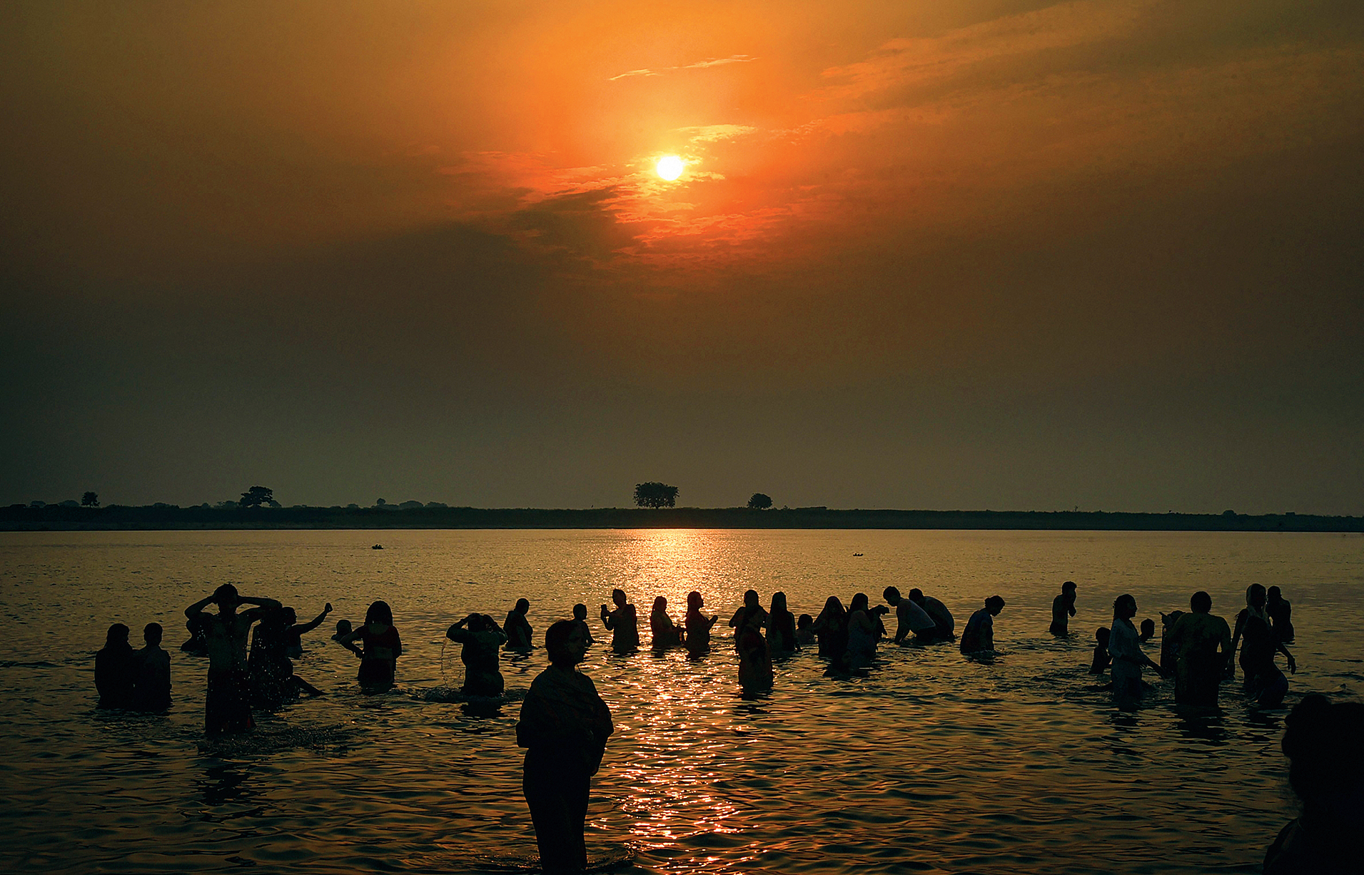 Devotees pray and take a dip in the Ganga on Ganga Dussehra in Patna on Monday.