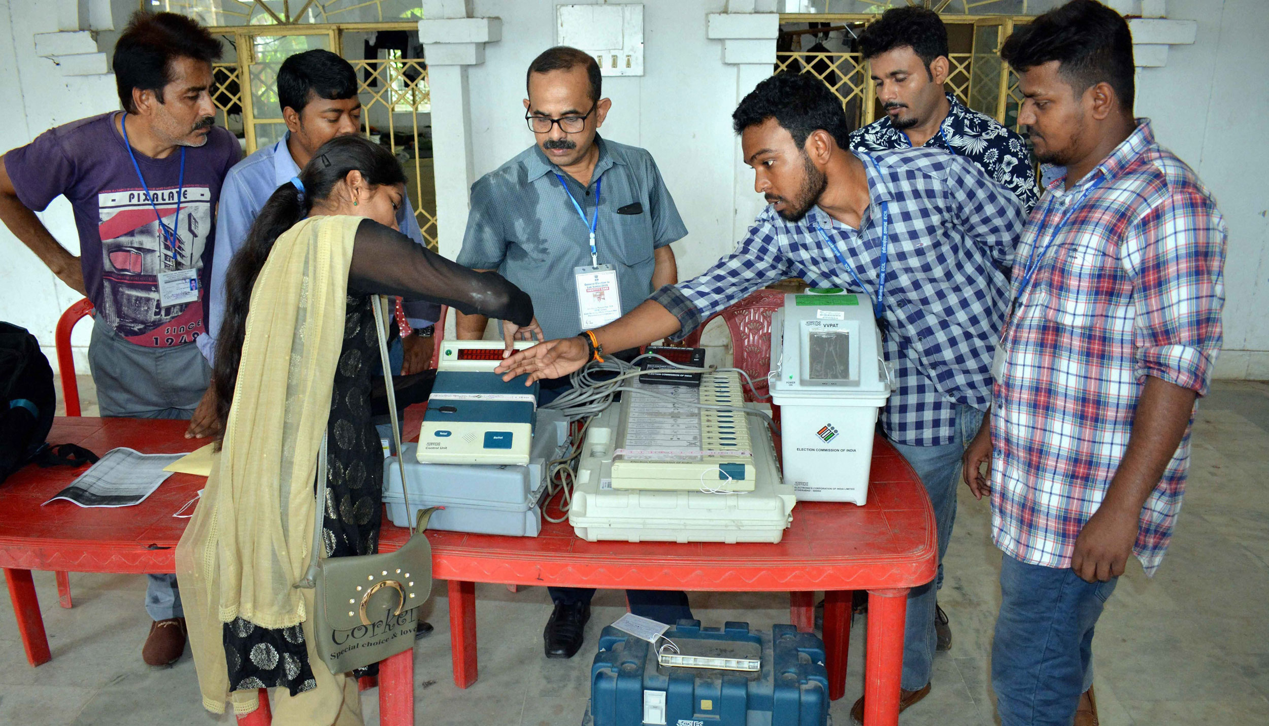 Election officials check VVPAT, EVMs and other polling materials before leaving for polling centres ahead of the sixth phase of Lok Sabha polls, in Agartala, on May 11, 2019.