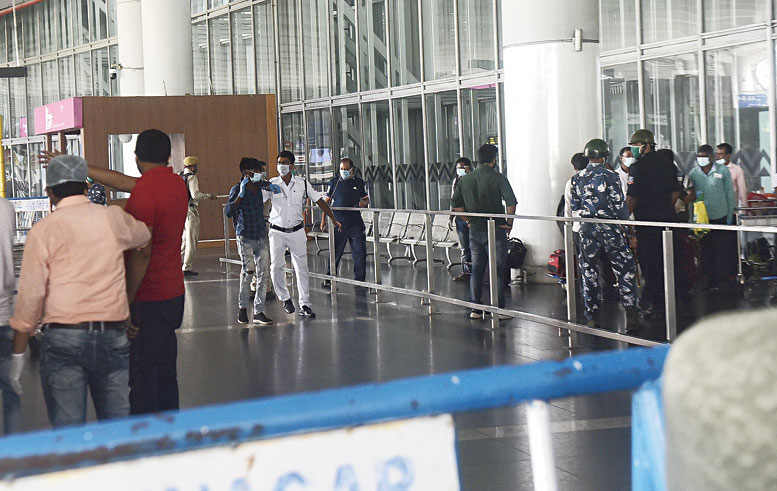 A passenger who arrived in the city from Bangladesh on Saturday tries to leave the airport instead of going to a government-run quarantine centre. A policeman catches him