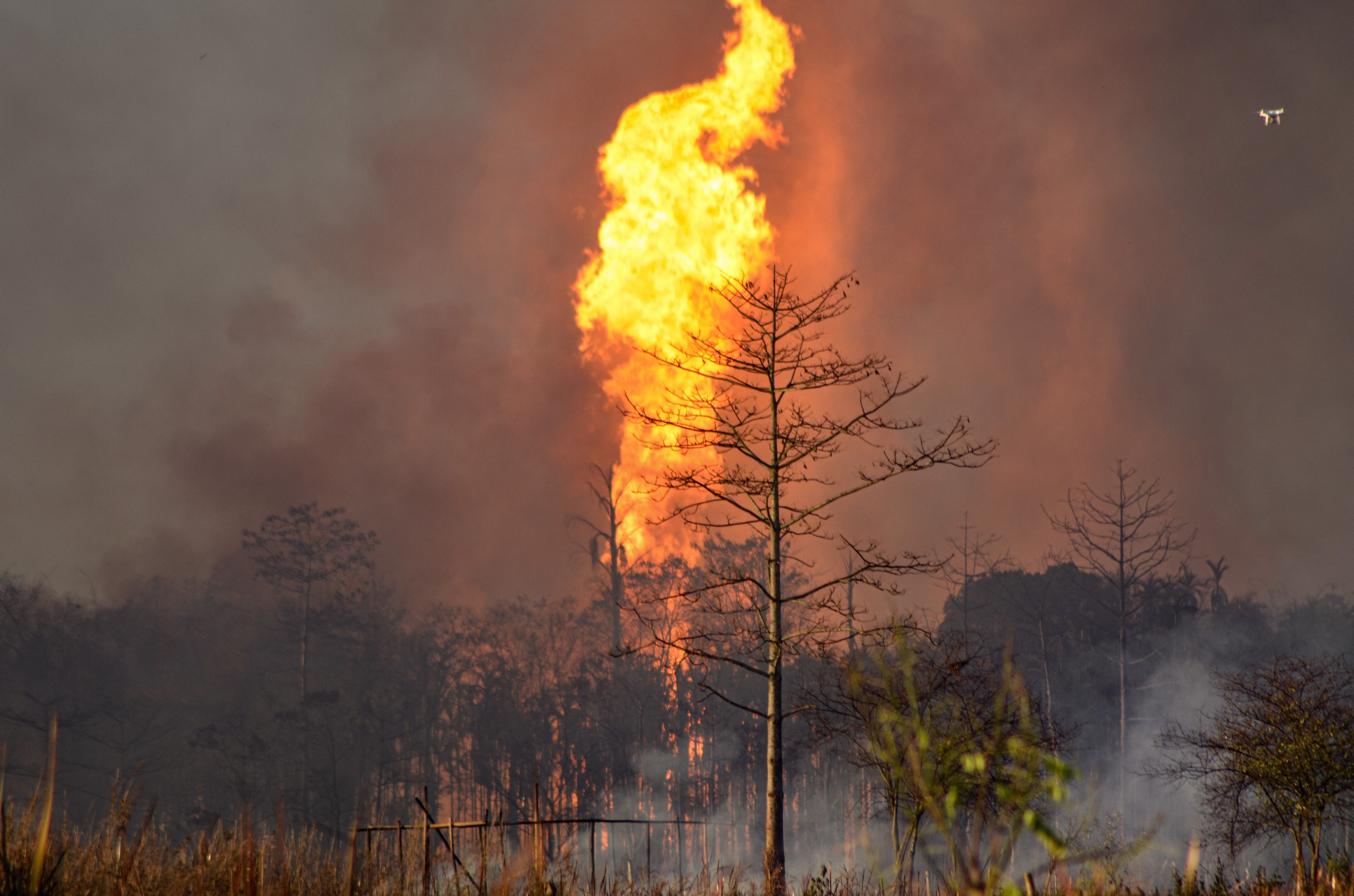 Smoke billows from a fire at the Baghjan oil field, a week after a blowout, in Tinsukia district, Tuesday, June 9, 2020.