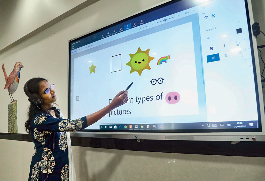 A teacher takes an online class for school students in Kozhikode on Monday.