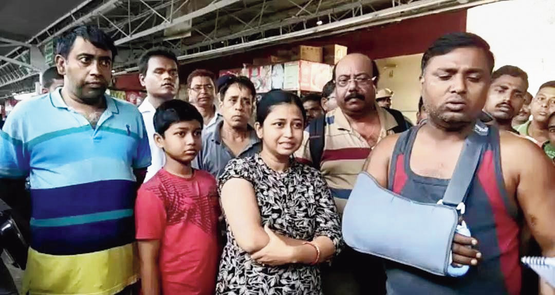 Some of the passengers at the Malda Town station on Saturday.