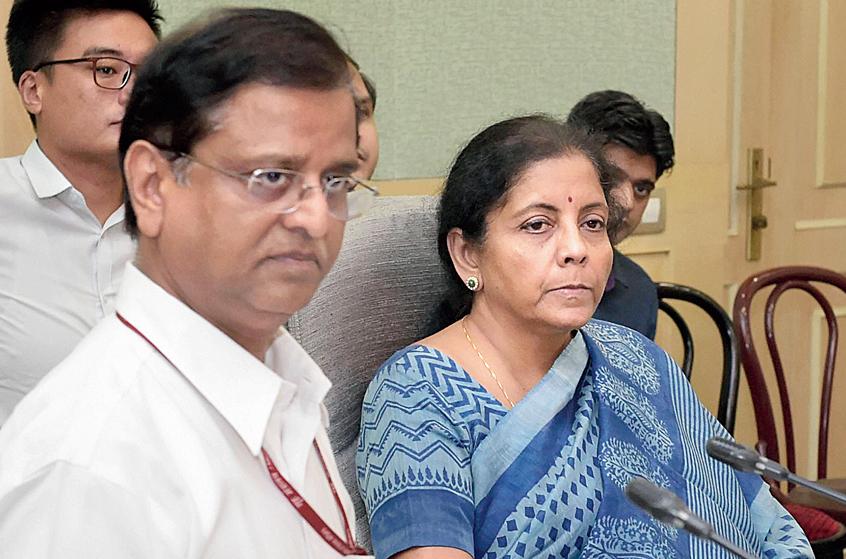 Nirmala Sitharaman with finance secretary S.C. Garg (left) in New Delhi on Friday.