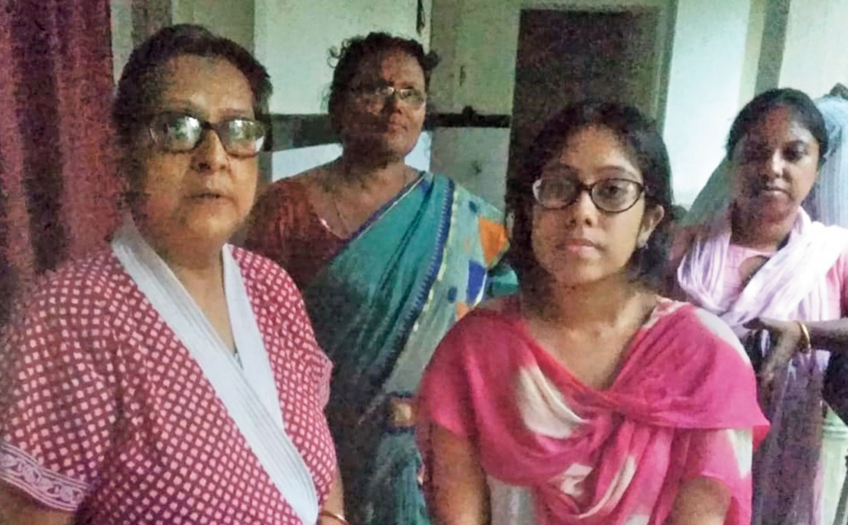 Shila Dey with her daughter Anindita at the Sealdah hotel where they have been staying since moving out of their Bowbazar house on Sunday afternoon.