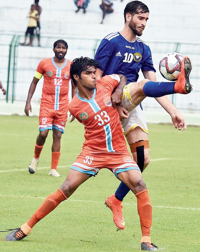 Danish Farooq and Chennai City's B. Sriram vie for the ball