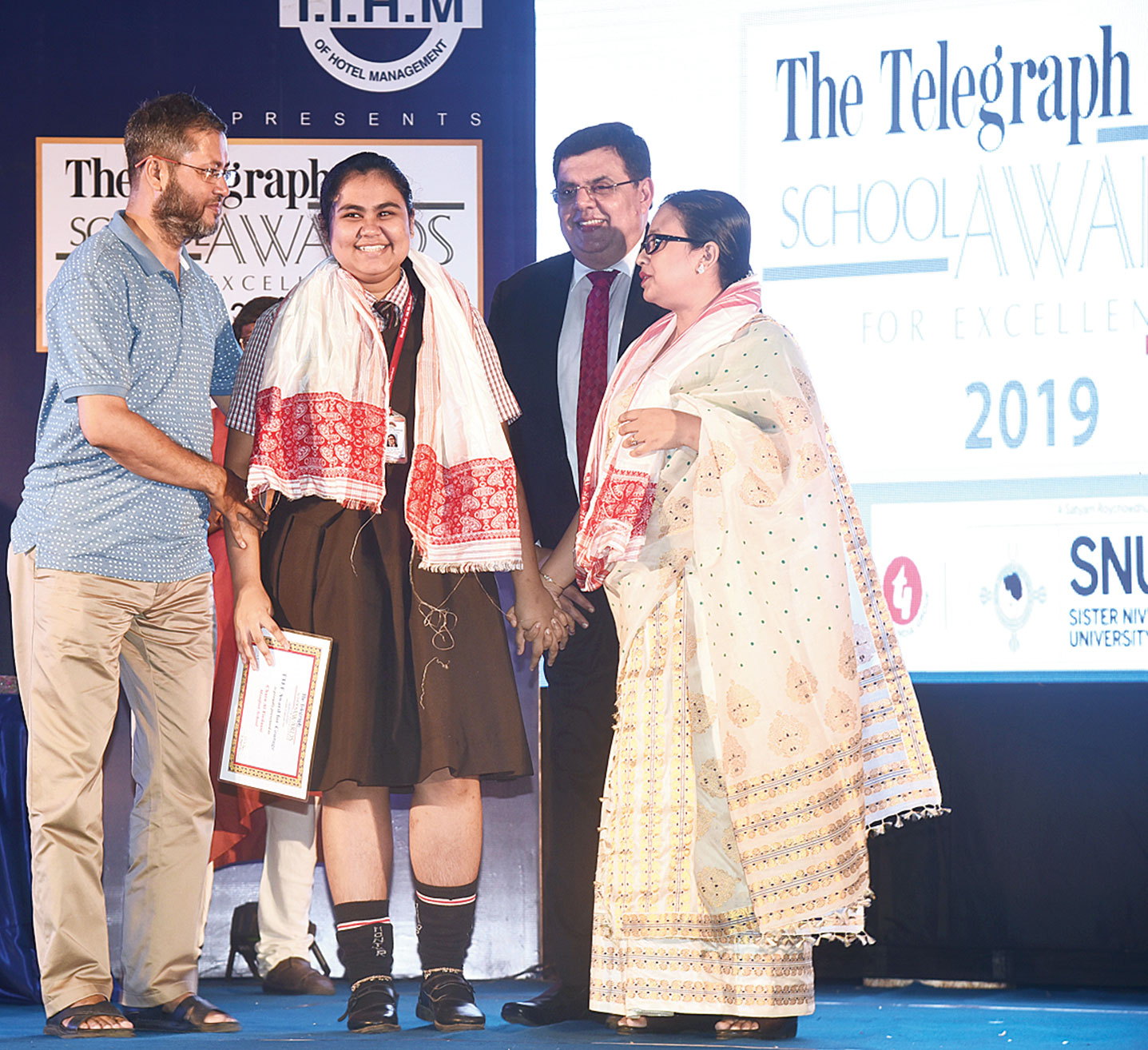 The Telegraph School Awards for Excellence 2019 witnessed a rare moment when Chara Al-Firdausi (second from left) came face to face with her mother Atifa Shahnaz Begum (right) on stage.